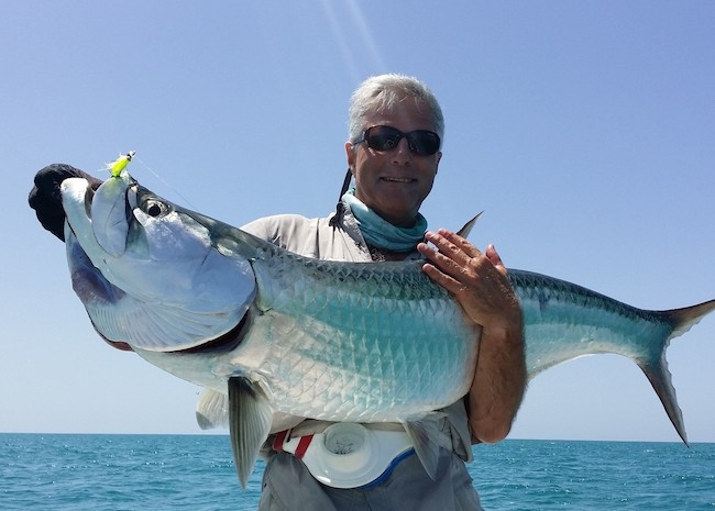 Zac showing the rest of the group his big fish in Ascension Bay.