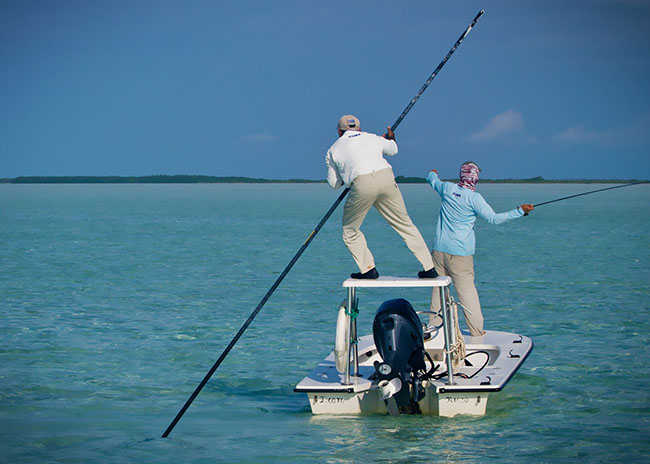 Rigoberto being oriented by his tour guide to fish the next game during his fly fishing tour.